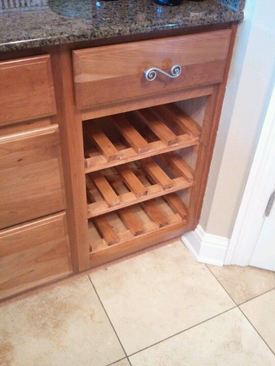 Diy wine rack used an empty garbage can cabinet add it for How to build a wine rack in a cabinet