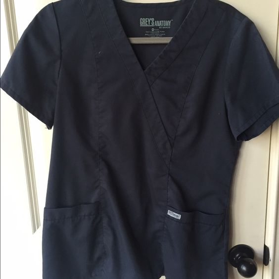 Greys Anatomy charcoal grey scrub top Sz M Worn only a few times and in perfect condition. This top is not the signature as it cinches in the back instead of the button straps. It's loose and comfortable and is a great top for every day wear. Sz. M Greys Anatomy  Tops