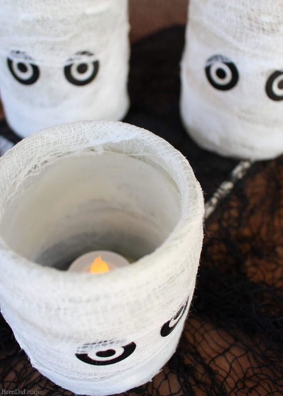 I love Halloween flipping through home decor catalogs for seasonal inspiration but can never quite convince myself to pay the sky-high prices. Learn how I make this easy homemade Halloween decoration that looks like a Pottery Barn candle holder.