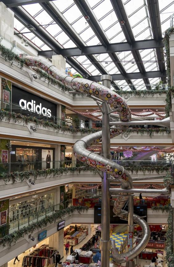 Shop and slide five-storeys down a twisting steel slide installed in a Shanghai shopping mall