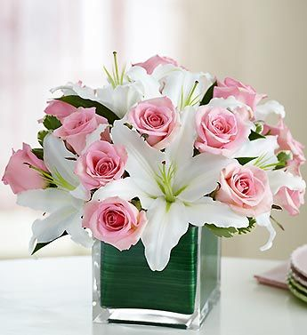 Contemporary elegance meets classic style with this stunning bouquet. Gorgeous fresh pink roses share the stage with showy white lilies...:
