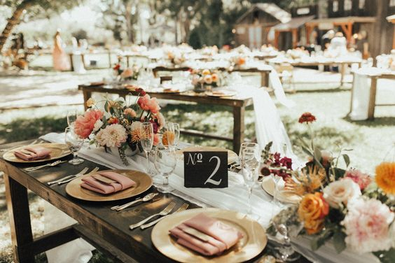 Corals + pinks created a summer feel with gold accents and rustic decor | Image by Rachel Wakefield Photography