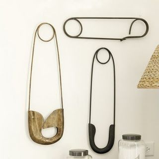 Large focal point- oversized vintage safety pins. Want!