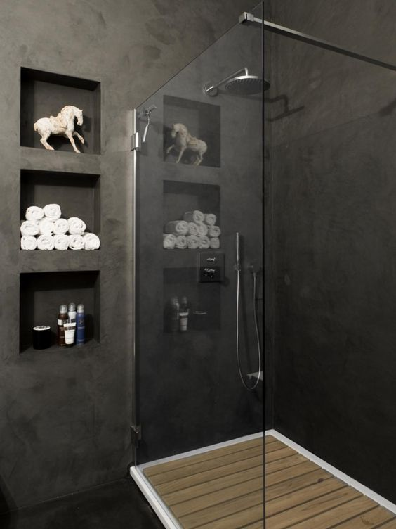 bathroom with dark grey walls, cubby-holes between studs, and a shower with…