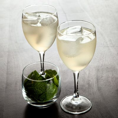 PLEASED AS PUNCH: citroen vodka, st germain, fresh lemon juice, mint and sparkling wine