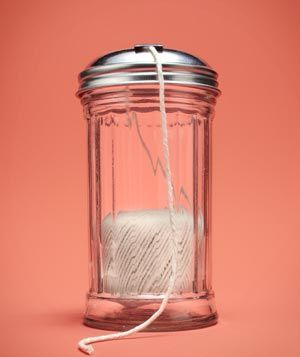 **Sugar Dispenser as Kitchen Twine Holder  Keep kitchen twine from tangling and jamming your drawers by using a glass sugar dispenser as a spool. Simply place the twine in the jar and thread through the open hole.