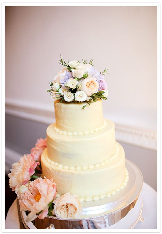 Simple cake - decorate with beautiful fresh flowers, skip the silly bride and groom toppers  Classic White Wedding Cake with Pink, Peach, and Violet Flower Topper
