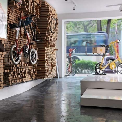 This bicycle shop in Hong Kong features a display wall made from 5,412 recycled paper tubes that can be pushed in and out as needed to cradle, hang, or provide support to the store's products. It's like a cool 3D wall mural!