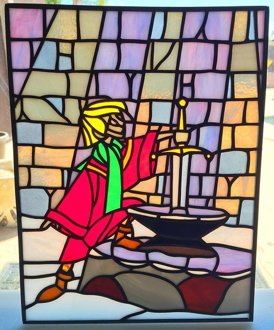 'Sword and the Stone' by @arts.and.artifice includes a free wave of nostalgia! One of many awesome pieces from this artist definitely one to watch! We are now accepting feature requests again for art/craft/clothing so get in touch! #art #stainedglass #kingarthur #swordandthestone #disneyart #childrensstory #stainedglassart #glassart #glassworks #glassporn #artoftheday #artistsoninstagram #artofinstagram #artstagram #artistsofinstagram #artsandcrafts #craftagram #instacraft #crafty…
