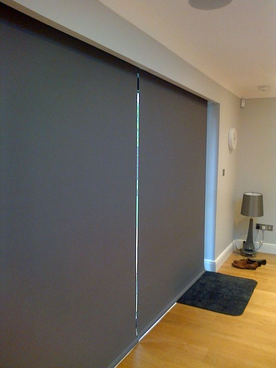 Keep the heat in next to your Bifold doors with Electric Blinds from Deans Blinds & Awnings