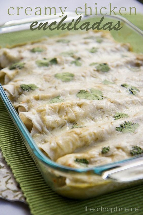 Creamy chicken enchiladas topped with green chili sauce.
