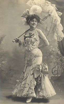 Vintage Photo of a Young Lady in Ruffles & Carrying a Parasol  This is the size I think of for 1890s parasols.: