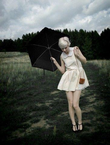 black umbrella. white dress.