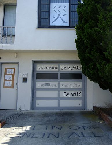 "From the Sunset District in San Francisco. A poem by Wen Tianxiang is written on their garage door that describes death and his loyal heart. The word ""disaster"" is written on their window."