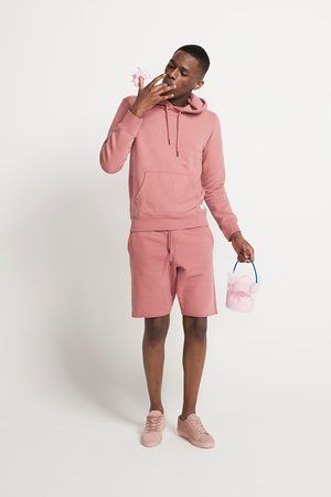 Shore Leave pink hoodie and pink shorts from Urban Outfitters, Asos pink trainers