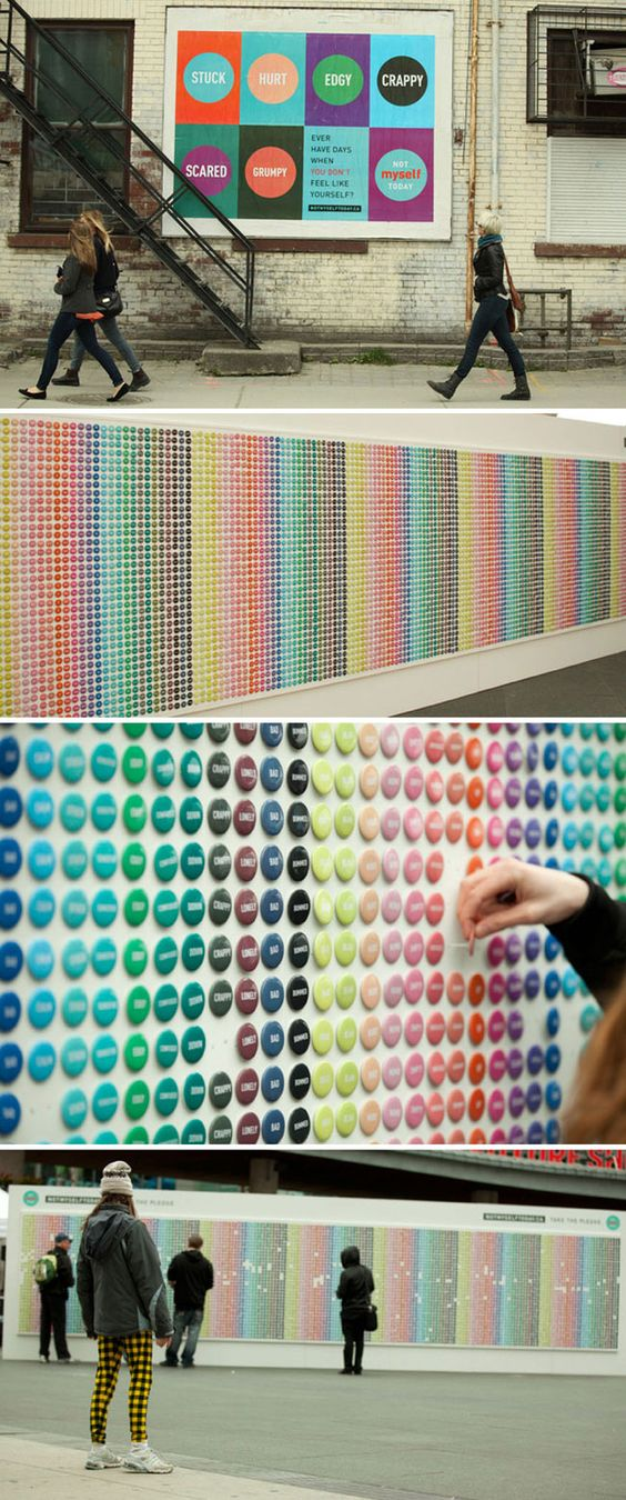 """The button wall at top created by Blok Design for the Partners for Mental Health campaign """"Not Myself Today"""". The identity, which uses different emotions and their corresponding colours, was turned into a wall of """"mood pins"""" in a heavily travelled section of Toronto."""
