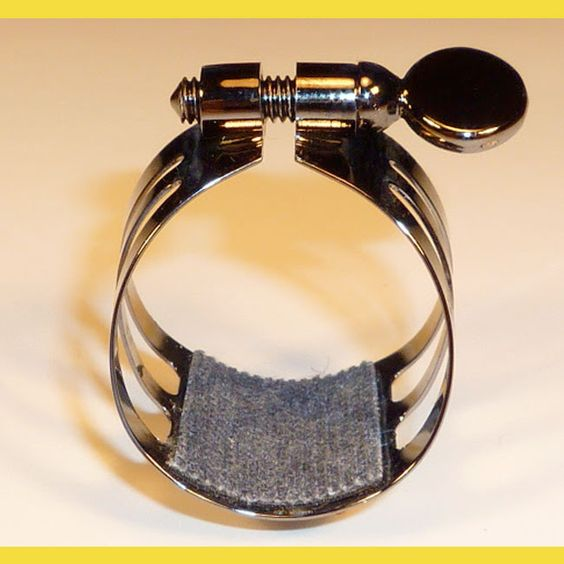 CL.AS Ligature, Black-silvered, Thick canva, with cap. Original creation by Roger PETIT. Special ligature for Bb-Clarinet and Alto Saxophone, rubber mouthpieces