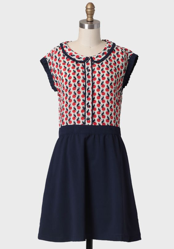 Camille Printed Dress By Dear Creatures 94.99 at shopruche.com. Feel Parisian any day of the week in this darling dress showcasing red polka dots on cream with a navy cat pattern and solid navy skirt. Dress finished with a pleat-trimmed peter pan collar and sleeves for feminine flair. Features front...