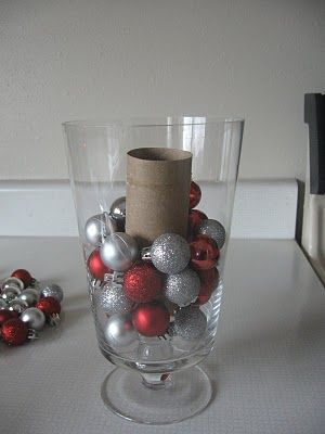 Remember to use a toilet paper roll as a filler- makes ornaments go further in filling vases!  Maybe spray paint same color of the ornaments to 'hide' it, too