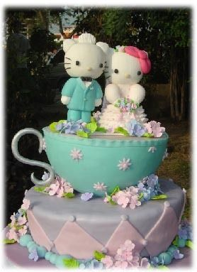 wedding cake with Mr. hello kitty and Mrs. hello kitty