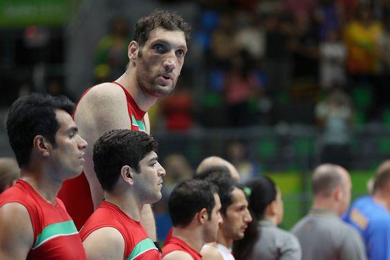 8-foot-1-inch-tall Morteza Mehrzadselakjani of Iran's sitting volleyball team…