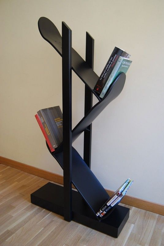 The Backflip 3.0 by Skate-Home. Shelf, bookstore or cd's holder, made of wood frame and shelves made up of 3 canadian maple skateboards. With the popularity of urban arts and graffiti on the rise– pieces crafted out of skateboard decks provide that simple touch of edginess without going too overboard.