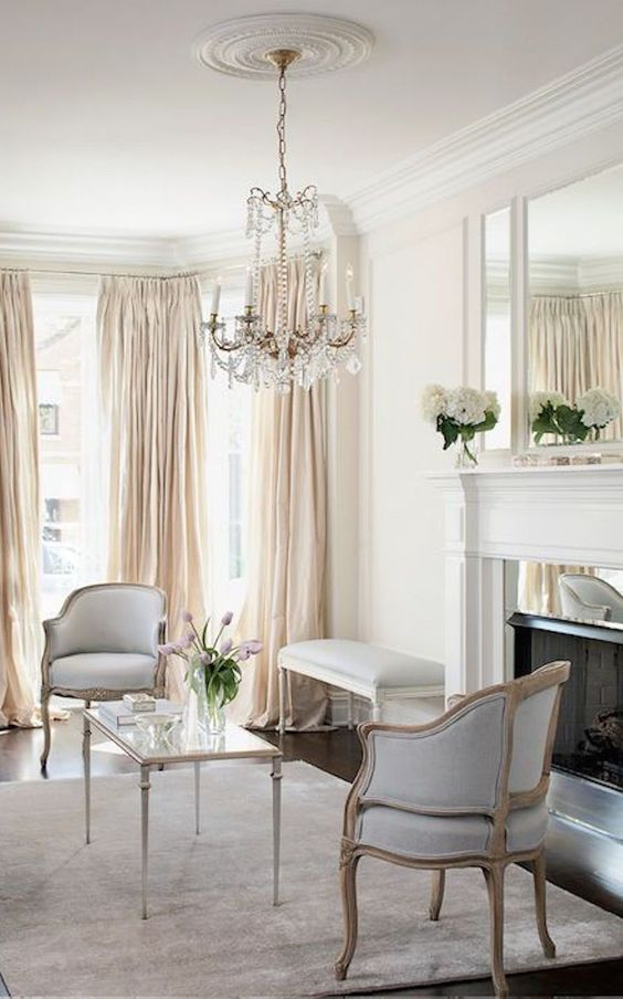 Pale Neutral Formal Sitting Room With Silver Accents An Oversized Triptych Mirror Crystal