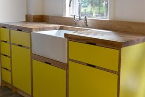 Love this kitchen: colourful & good handles, lovely worktops but concerned re mould & stains. Handle style implies ply cupboards too