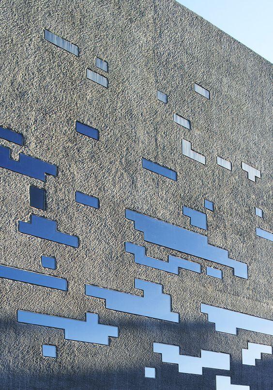 Concrete facade + glass & steel perforations -TEA Tenerife