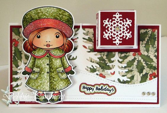 From our Design Team! Card by Debbie Pamment featuring Winter Coat Marci and these Dies - Three Christmas Trees, Double Stitched Hills, Stitched Ribbon, Heart Snowflake - small (retired) :-) Shop for our products here - http://lalalandcrafts.com/ Coloring details and more Design Team inspiration here - http://lalalandcrafts.blogspot.ie/2016/08/stitches.html