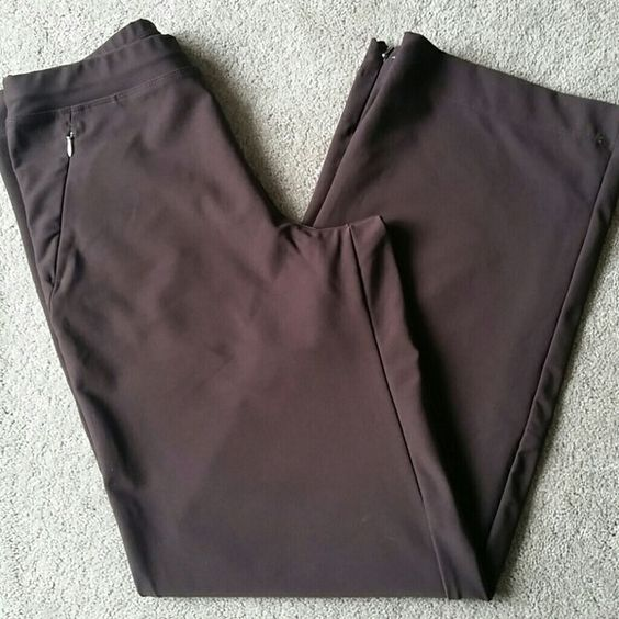 Lucy 'Everyday' Pants Size Small Lucy 'Everyday' Pants. Size Small. Color: Chocolate Brown. 30.5in inseam. Relaxed fit. Comfortable elastic waist band. Moisture wicking fabric. Two front hidden zipper pockets. Hidden silver zipper at each ankle. In beatiful condition! No stains, rips, tears, or holes. 88% micro poly, 12% spandex. Feel free to ask any questions. MAKE ME AN OFFER! FREE GIFT with every purchase! Bundle for further discounts. Lucy Pants