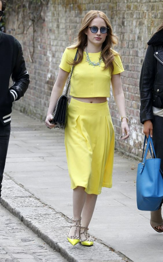 Pin for Later: All the Made in Chelsea Girls' Finest Fashion Moments  Rosie chose a bright yellow two-piece with matching studded shoes whilst filming the new series in London in April 2014.