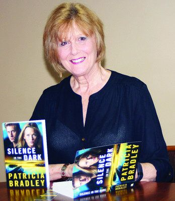 "Local author Pat Trainum will have a book signing on Saturday to promote her latest book ""Silence in the Dark."""