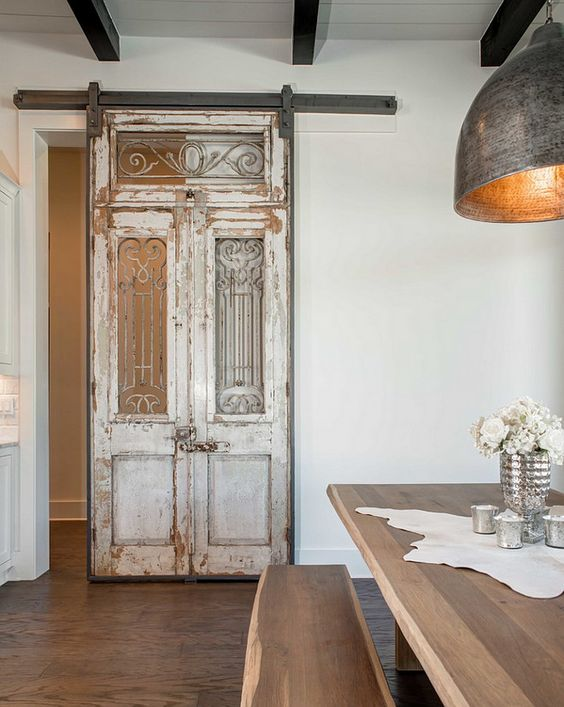Antique french doors and transom used to create a sliding for French door barn door