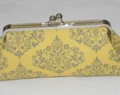 yellow and gray clutch