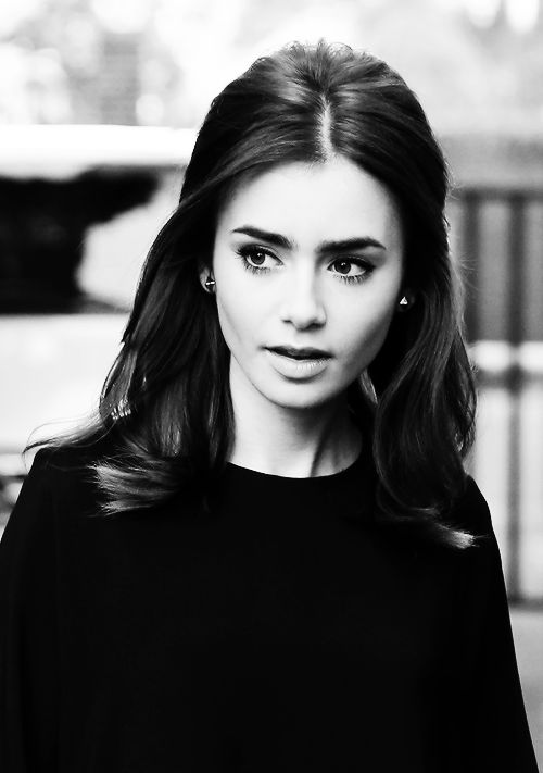 Lily Collins. She so beautiful and her hair is perfect.