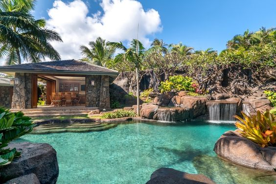 Tropical Swimming Pool with Pathway, Fence, Raised beds, Gazebo, exterior stone…