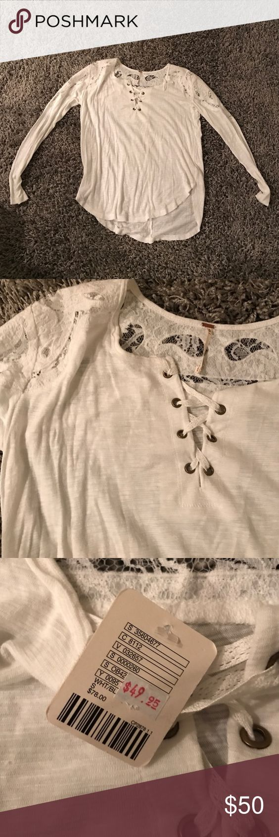 Free people white S lace up Brand new free people lace and lace up top. Not sold in stores anymore. Been sitting in my closet so a little wrinkled, but throw it in the dryer. Size small, white Free People Tops Blouses