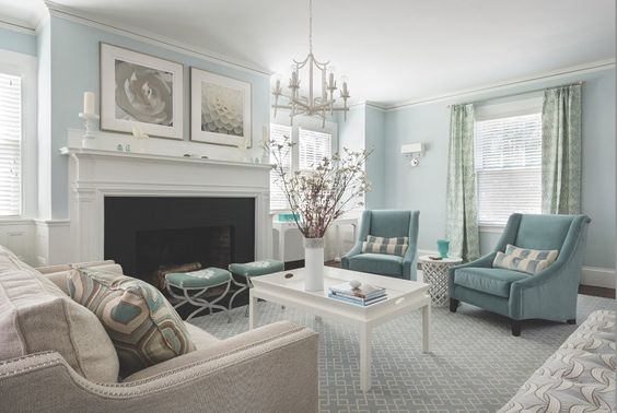 "Designer Jocelyn Chiappone used Farrow & Ball's ""Borrowed Light"" paint color on the walls and incorporated furniture with clean lines to give the home a modern seaside vibe."