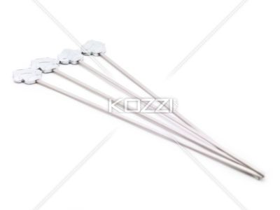 Right Pointing Meat Skewers - Meat skewers arranged and pointing towards the right on white.