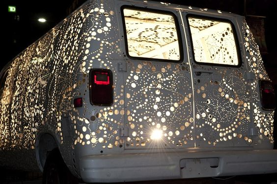 Artist Kim Adams turned this Dodge Ram van into a moving spectacle of lights!