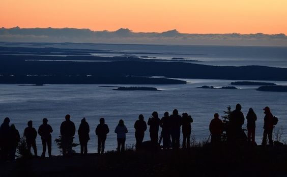 Those who make the pilgrimage up Cadillac Mountain — the highest point on America's Eastern Seaboard — are some of the first in the United States to see the sun peek over the horizon.