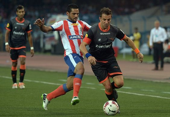 Delhi Dynamos FC footballer Alessandro Del Piero (R) in action with Atletico de Kolkata footballer Baljit Saini during the Indian Super League (ISL) football match between Atletico de Kolkata and Delhi Dynamos FC at The Salt Lake Stadium in Kolkata on October 19, 2014.