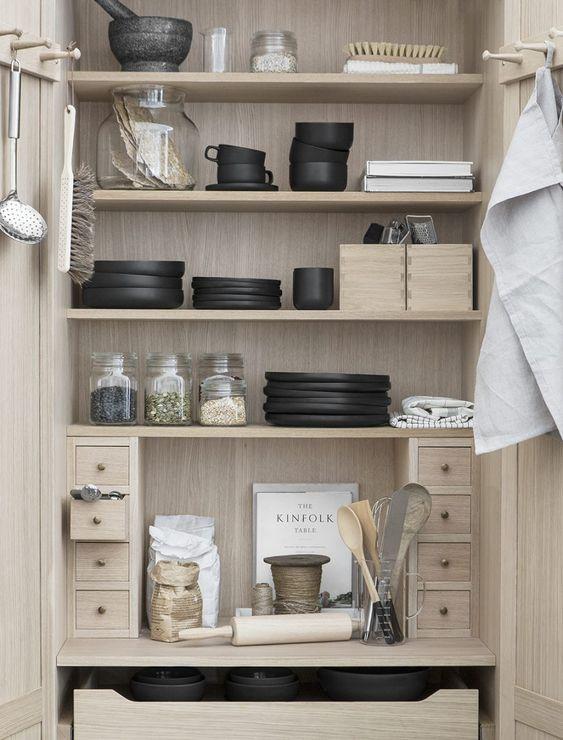 Compact kitchen storage | black bowls and plates | wooden kitchen cupboard storage