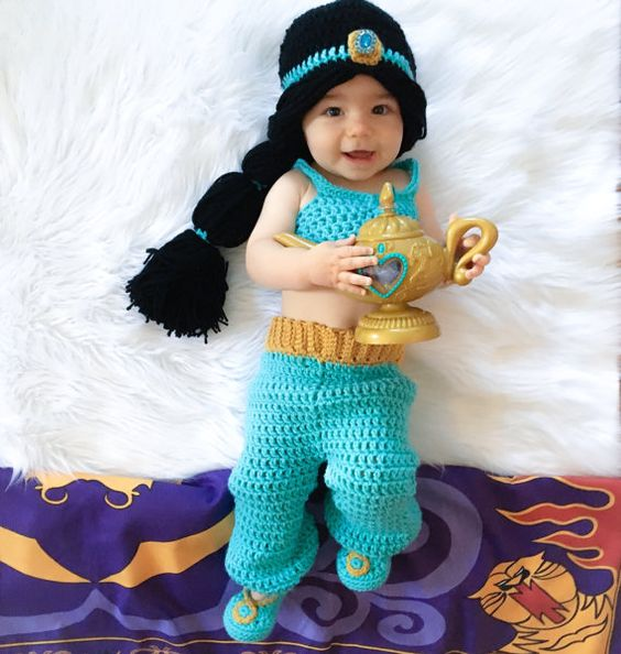 Your little princess will look adorable in this princess Jasmine inspired outfit! Set includes wig hat, top, pants and shoes. This set would also make a great photography prop or baby shower gift. Color: Teal and Gold Material: 100% Acrylic Yarn  Sizes: Newborn 0-3 Months 3-6 Months 6-9 Months All my items are made in a smoke and pet free home.  Care instructions: Hand wash in cold water & lay flat to dry  PLEASE SEE MY SHOP ANNOUNCEMENT FOR CURRENT TURNAROUND TIME  Boutique items without the hi