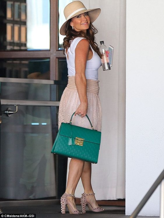 Summer style: Kyle hit the right note in a sleeveless top and lacy skirt...