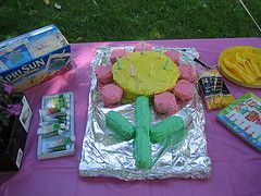 Flower birthday cake.  Round cake plus Twinkies for the stem and leaves and Ding Dongs for the petals.