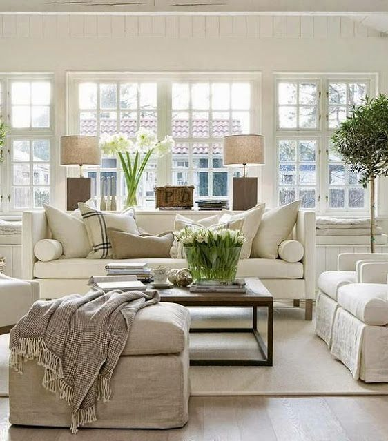 I like the feel of this room - cozy, neutral colors, balanced furniture. Also like the table behind the couch.:
