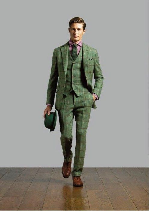 Green three-piece suit paired with green tie, brown shoes, green
