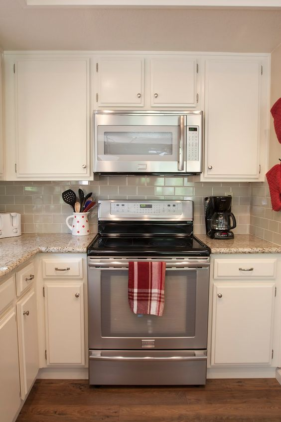 Kitchen subway tile backsplash white kitchen cabinets blue accents